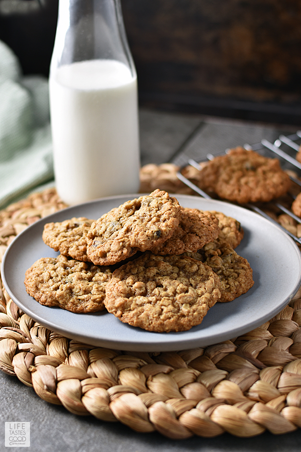 A plate of Quaker Oatmeal Cookies with a tall glass of milk