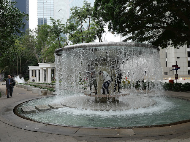 Playing in the fountain at Hong Kong Park