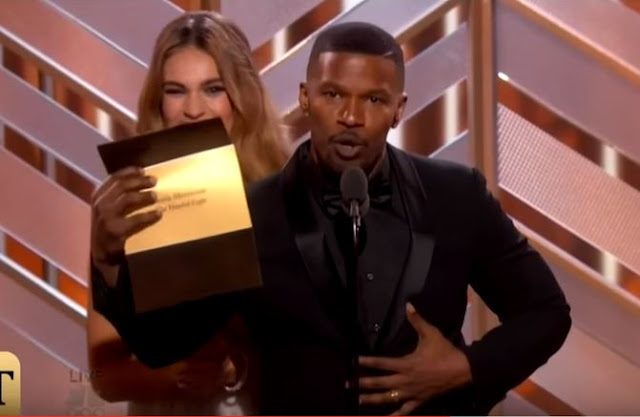 Lily James and Jamie Foxx onstage during the 73rd Annual Golden Globe Awards
