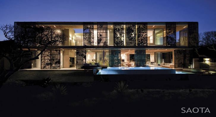 African modern villa in Durban by SAOTA at night