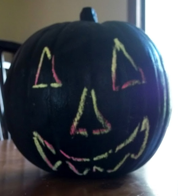 Make a Plastic Pumpkin Painted with Chalkboard Paint.