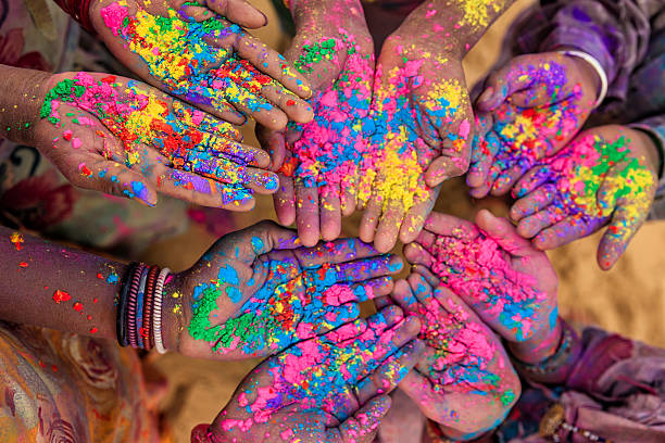 hands with holi color