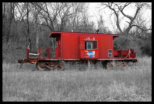 An old Missouri Pacific (MoPac) platform caboose sits rusting away in the weeds at Ste. Genevieve, MO.