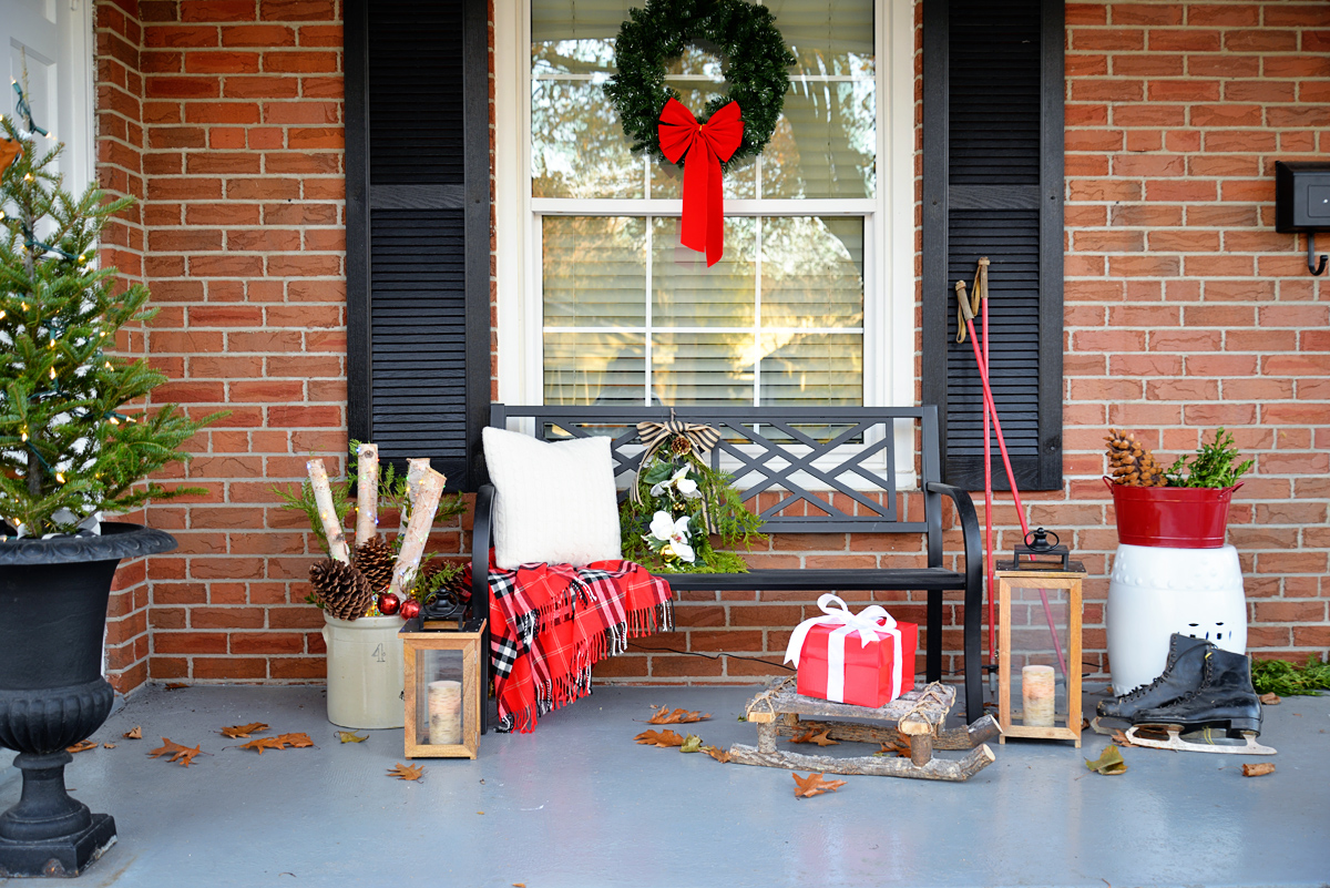 christmas porch decor, porch bench with christmas decorations, ski poles as decor, birch branches in crock