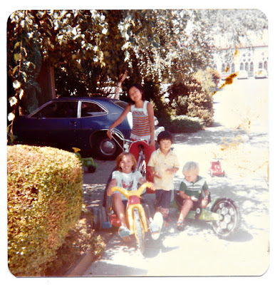 Yoorah and Laju Lee, and Dionne ride bikes on Ramona Avenue in Piedmont in 1980