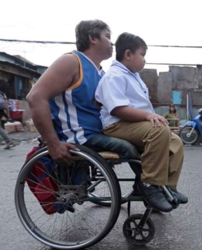 A Disabled Father Brings His Son To The School While In His Wheelchair