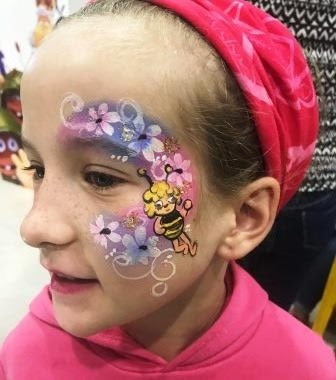 Maya the bee face paint on girl's face