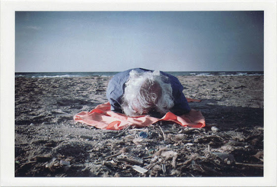 dirty photos - time - cretan landscape photo of old man sleeping at the beach