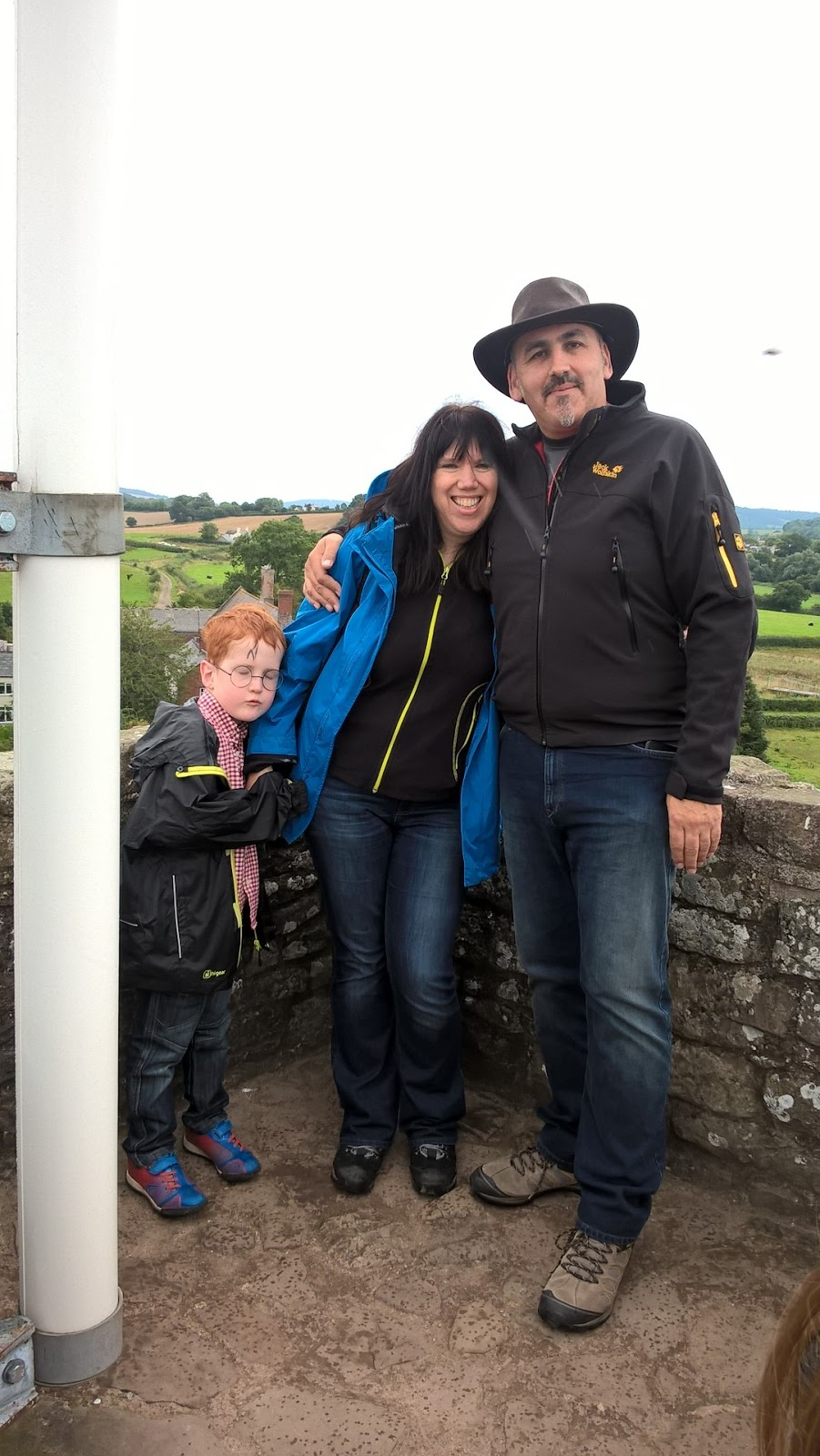 Anil John Nayar, Sarah Brooks-Nayar and Ieuan Hobbis on the ramparts at Raglan Castle