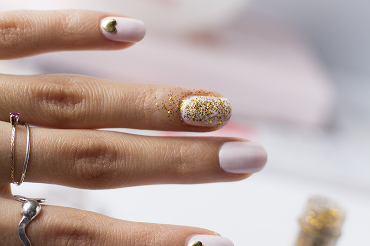 pink and gold glitter nail look