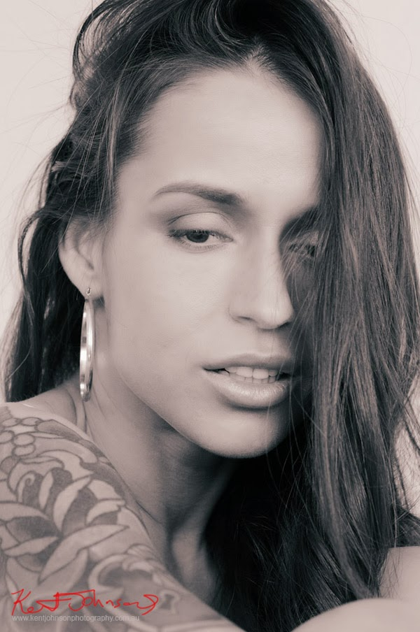 Modelling portfolio Headshot/Portrait,  Girl with tattoo, hoop earrings and wild hair. Photo by Kent Johnson.
