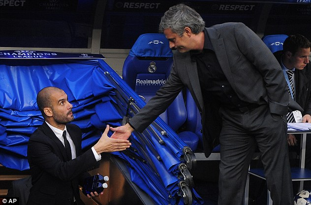 Pep Guardiola shaking hand with Jose mourinho