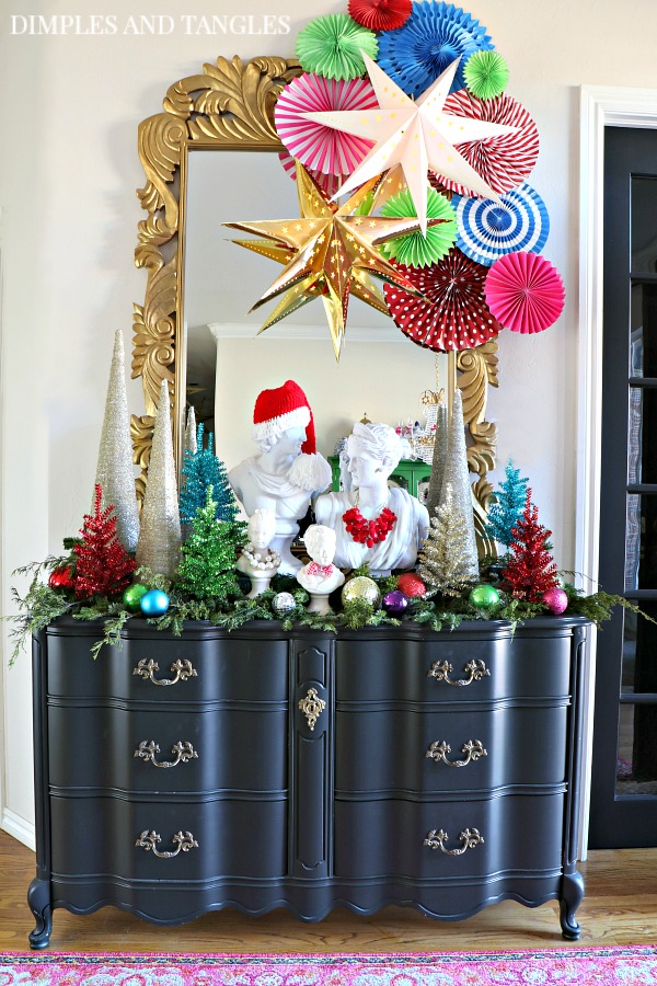 black dresser, french provincial, paper fans, party fans, 3D stars, bust, tinsel trees, Christmas Entry Decorations