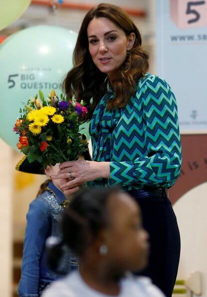 During the visit, Kate Middleton wore a new turquoise and navy print blouse by Tabitha Webb. Tabitha Webb Pansy pussybow in green chevron