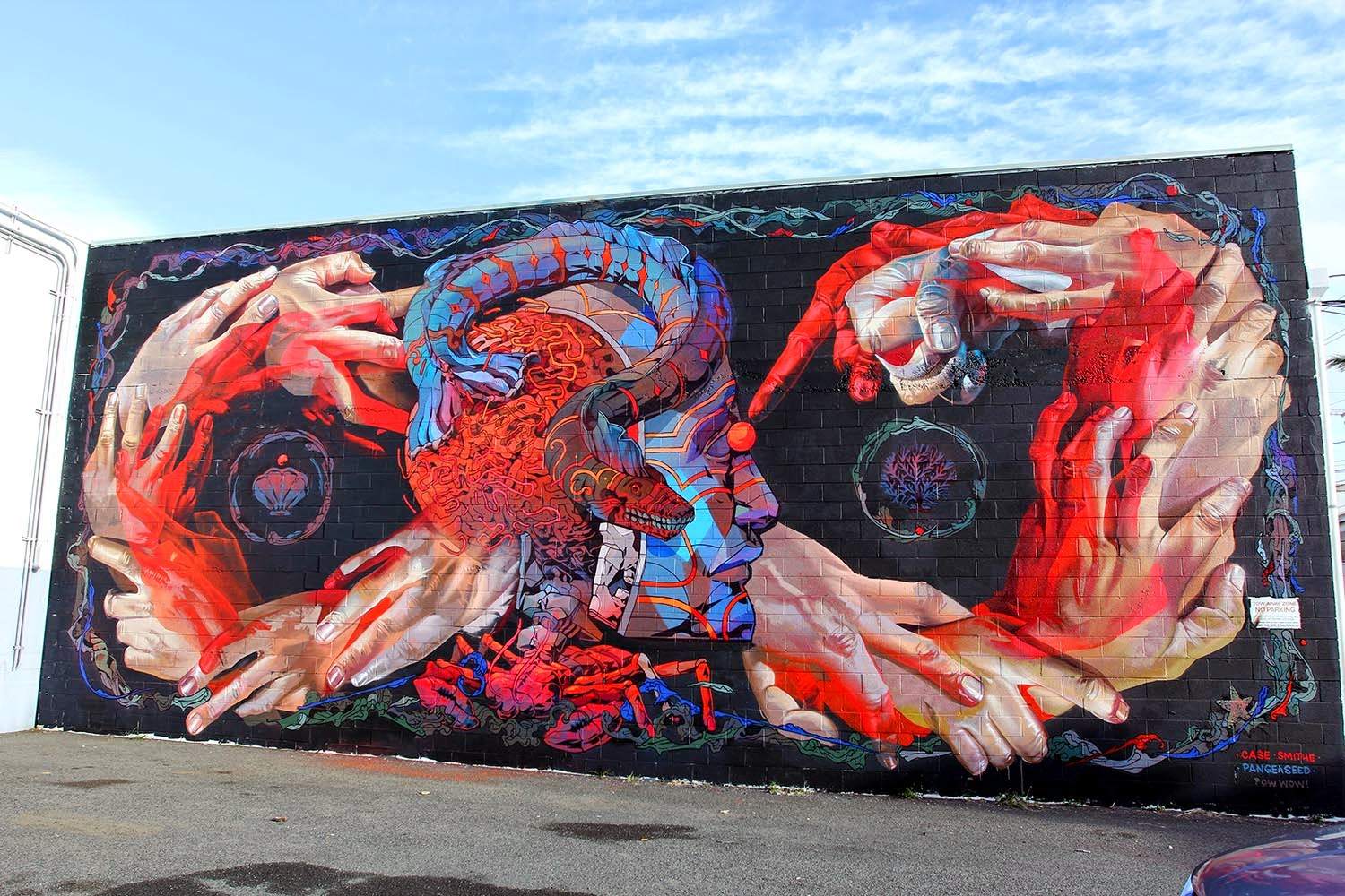 We continue our ongoing coverage of Pow! Wow! Hawaii 2015 with a stunning mural produced by Case Ma'Claim and Smithe.