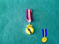 Foto de medalla en fimo con el escudo del Real Madrid