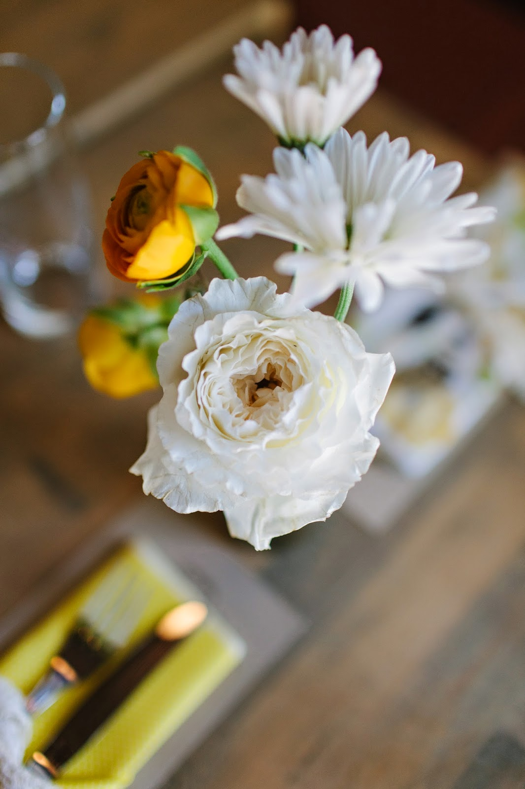 yellow ranunculus and white patience garden rose spring wedding dinner centerpiece in brooklyn, new york