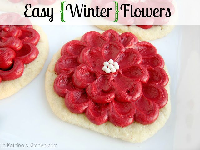 Circle sugar cookie with red frosting and white candies made to look like a flower