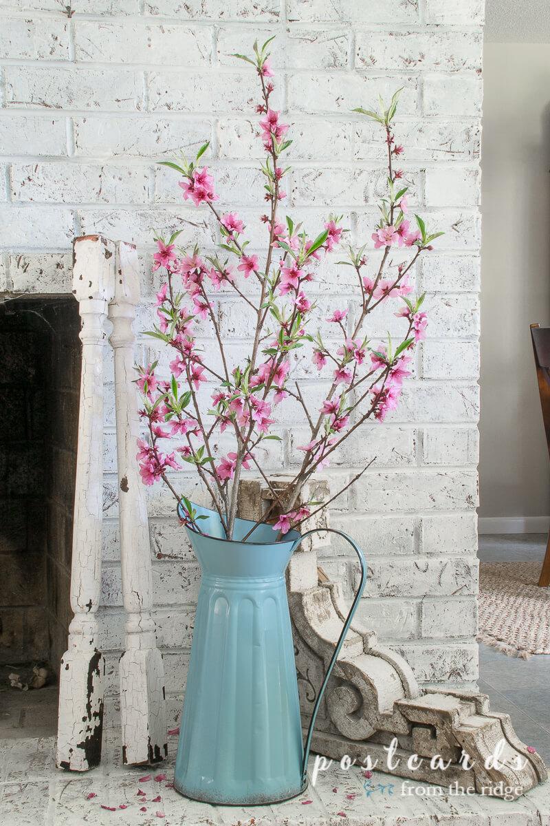 Spring Mantel Decor Ideas. Blue Pitcher With Peach Blossoms
