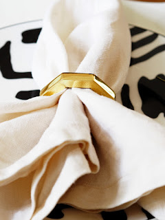 My Summer Dining Room - French For Pineapple Blog - close up of linen napkin with brass napkin ring on graphic black and white side plate