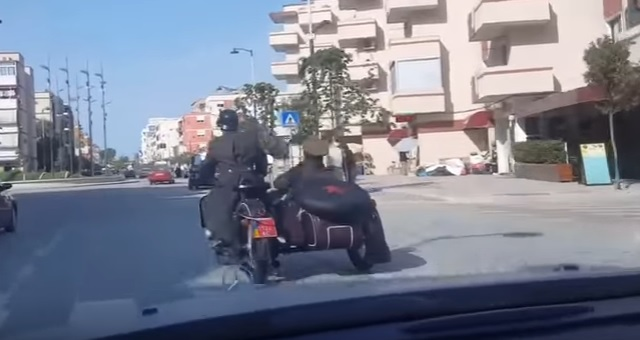 'Germans' on World War II motorcycle riding on Albanian roads