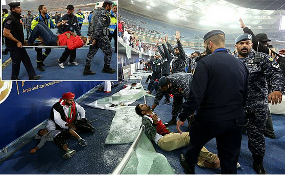 Over 30 football supporters injured after stadium's glass barrier breaks as fans celebrate in Gulf Cup victory (Photos)