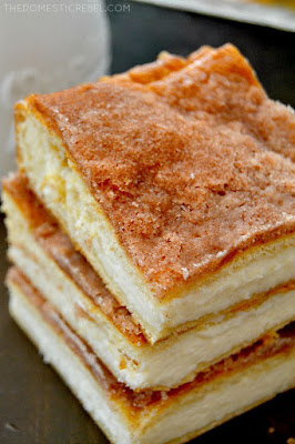 The Best and Easiest Sopapilla Cheesecake Bars are to-die for! Rich, creamy, cinnamon sugary delights that are a cinch to make!