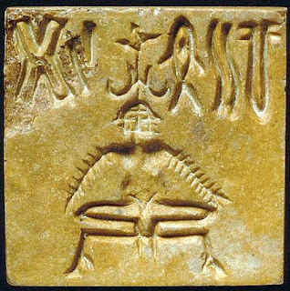 Mohenjo-Daro Seal No.222 shows a three-faced meditating yogi wearing a horned head-dress