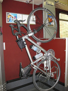 pep's bike suspended in a bike car on a Swiss train.