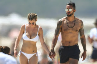 Walcott And Wife Melanie On Beach