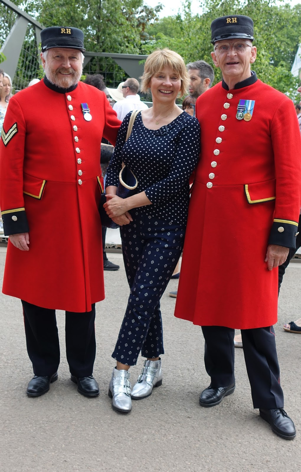 Wearing navy blue with silver, Gail Hanlon from Is This Mutton with two Chelsea Pensioners, Chelsea Flower Show 2017