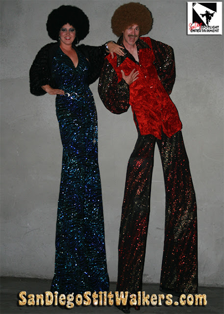 disco stilt walkers