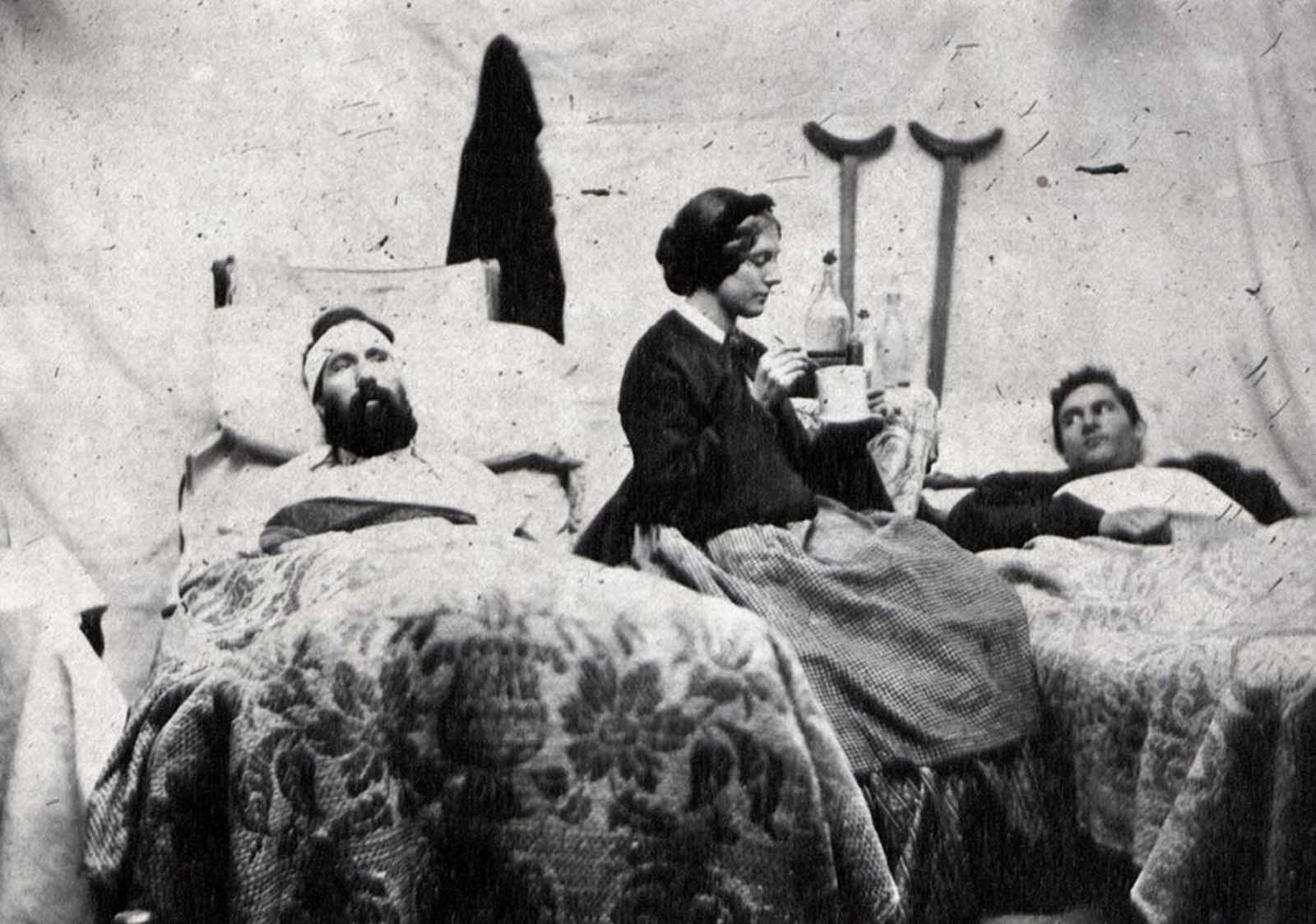 Nurse Anne Bell tending to wounded soldiers in a Union hospital, ca. 1863.
