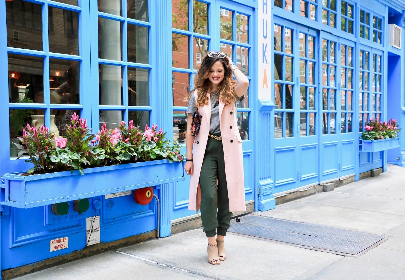 Nyc fashion blogger Kathleen Harper in a long sleeveless coat