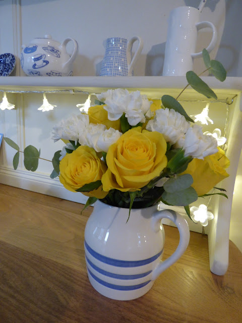 Hand tied posy flower arrangement in jug