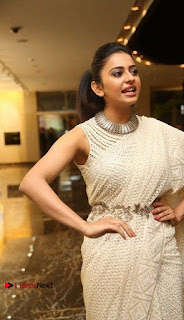 Actress Rakul Preet Singh Stills in White Dress at Winner Pre Release Function  0016.jpg