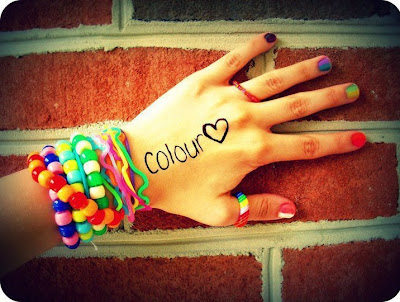 colorful bracelets in hand