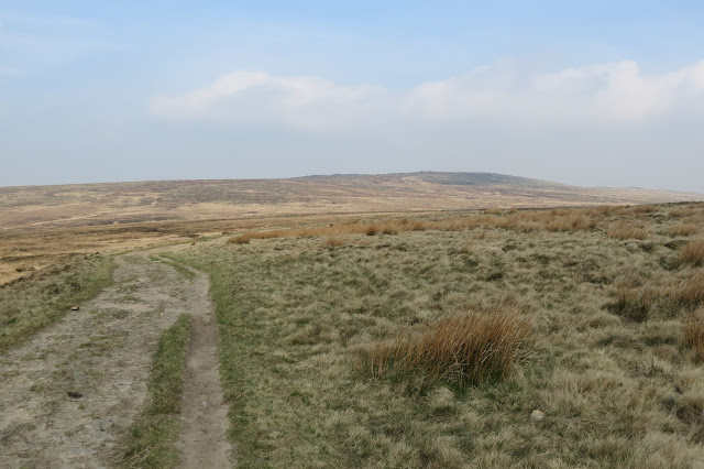 A broad track on the left heads across the moors towards Blackstone Edge on the horizon.