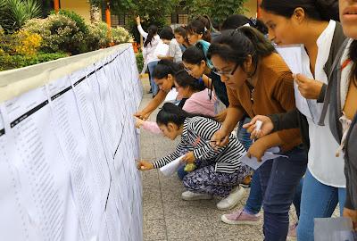 estudiantes ubican el local de la UNFV donde dar el examen de admision 2019-7 de abril