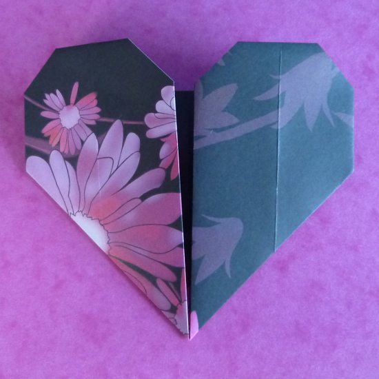 Paper folded heart shape craft