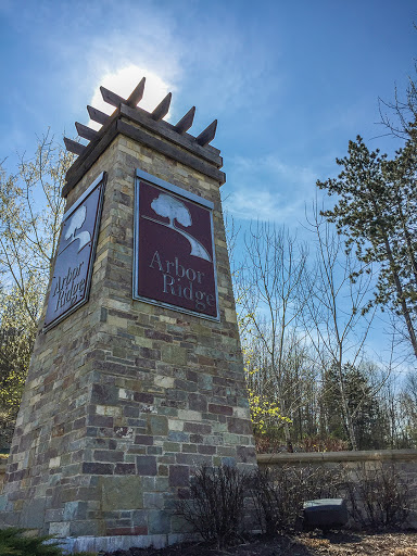 This monument sign for the Arbor Ridge Neighborhood is also the marker for the north Trailhead
