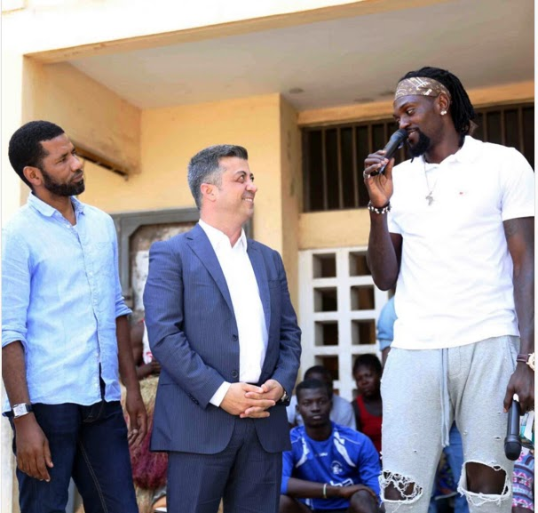 Togolese Footballer Emmanuel Adebayor visits the neighbourhood he grew up in TOGO