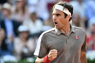 Federer reaches Halle semis