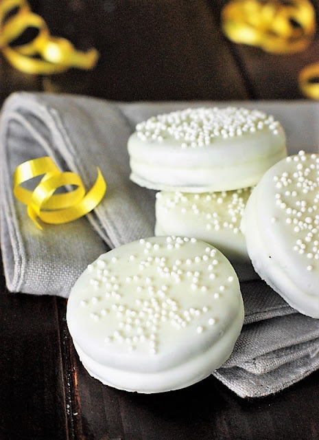 Bridal Shower White Chocolate Oreos Image ~ With a dip in white chocolate & sprinkling of white sprinkles, Oreos are ready to celebrate!  A fun and easy, crowd-pleasing bridal shower or wedding treat.   www.thekitchenismyplayground.com