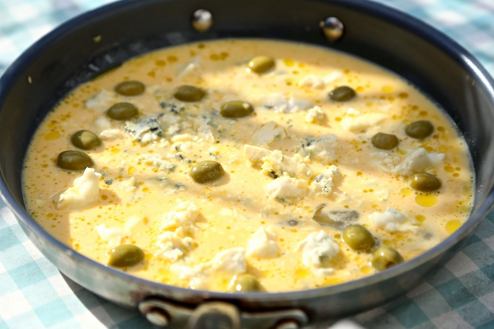 Uncooked blue cheese and green olive frittata