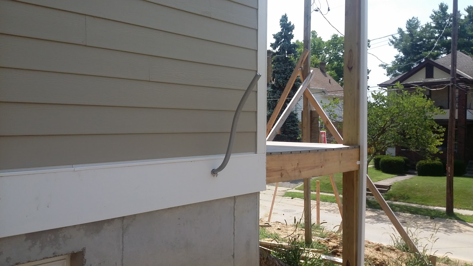 small resolution of  panel box in the front corner of the basement and providing conduits for the home run wiring and outlets mounted along the concrete foundation walls