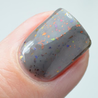 gray nail polish with color shifting flakies