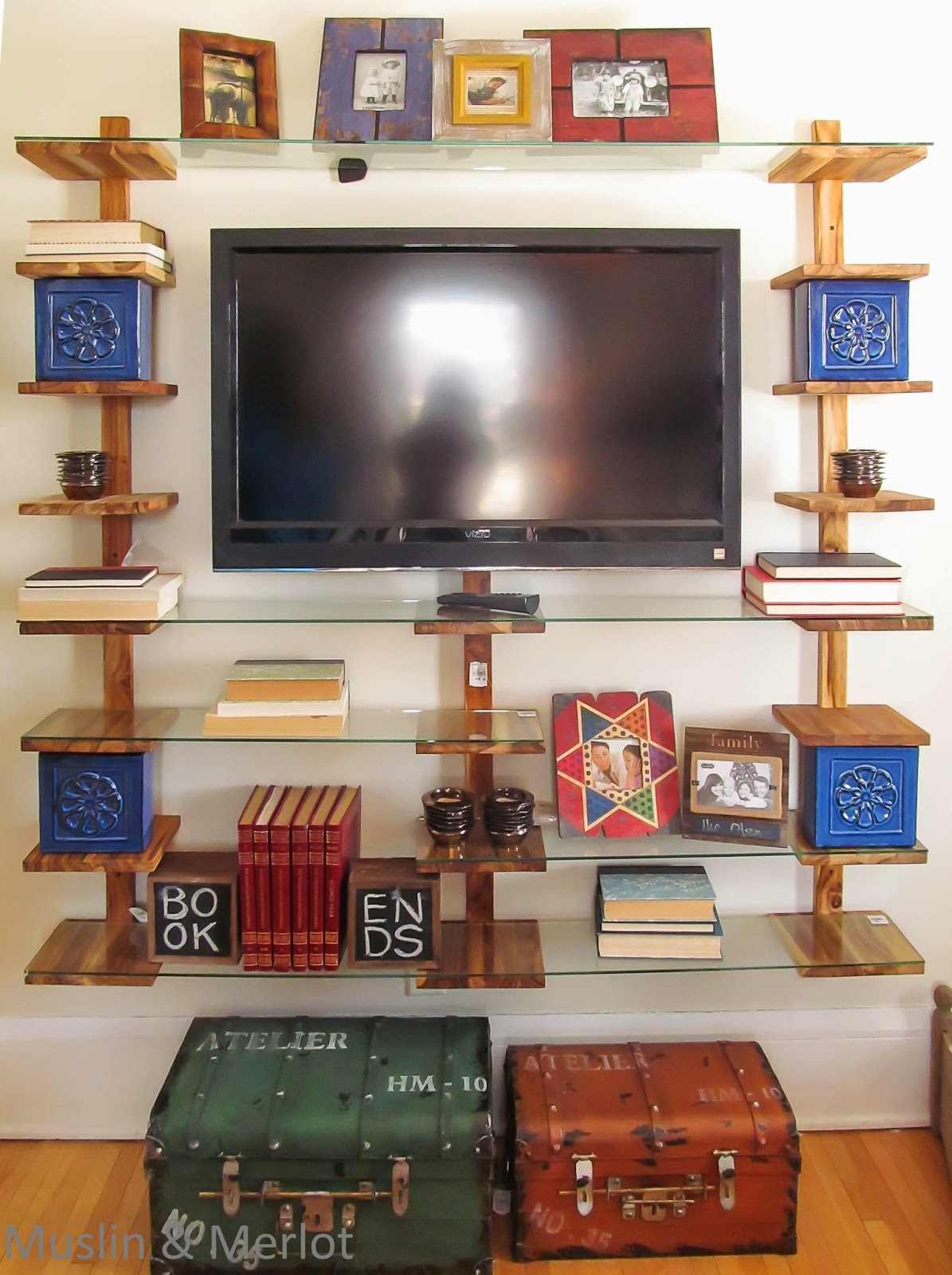 Narrow bookshelves + glass shelves = AWESOME!