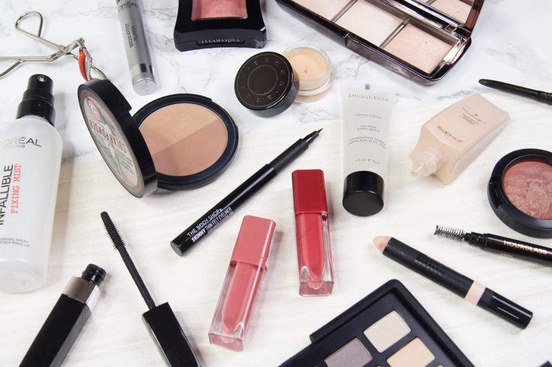 pretty glowing spring makeup look fresh dewy skin cat eye liner flick highlighted cheeks glossy lips