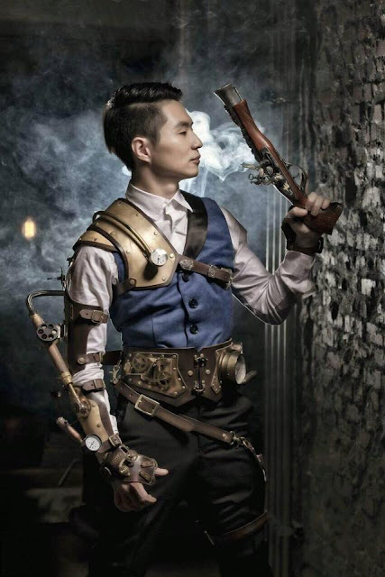 Steampunk man wearing a vest (waistcoat), trousers, gun, leather armor, steam arm. Men's steampunk fashion and clothing